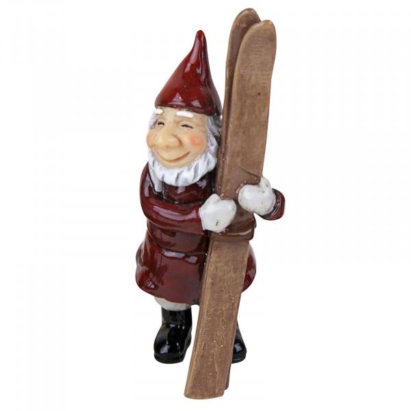 Harvesttime kleiner Weihnachtsmann mit Skiern im Arm